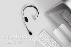 Contact concept , top view desk with headset, computer and conta Royalty Free Stock Photos