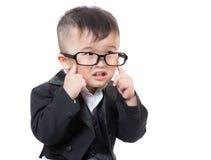 Contact de bébé d'affaires de l'Asie son oeil photographie stock libre de droits