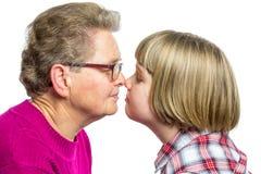 Contact de nez de grand-mère et de petit-enfant Photographie stock libre de droits