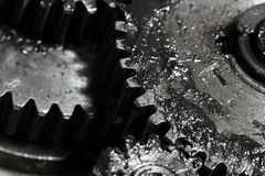 Contact of gear wheels in mechanism, concept of business partner Royalty Free Stock Photos