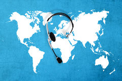 Contact global concept , top view headset and map. Blue stock photography