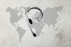 Contact global concept , top view headset and map royalty free stock photos