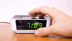 Contact of a hand of an alarm clock Stock Photography