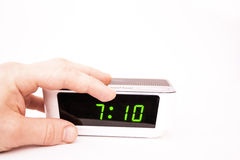Contact of a hand of an alarm clock Royalty Free Stock Images
