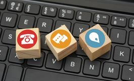 Contact Icons on black keyboard wood dices Stock Images