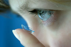 Contact lens. Girl is goung to put contact lens into her eye Royalty Free Stock Images
