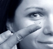 Contact lens. Woman holding a contact lens Stock Photography