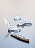 Contact lens. Disposable contact lens in open blister-pack with case and tweezers Stock Image