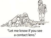 Contact lens. Football player looks for lens Stock Photography