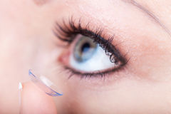 Contact lens applying, macro Royalty Free Stock Photo
