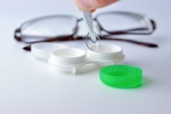 Contact lens and case. Stock Image