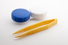 Contact lens case and tweezers Royalty Free Stock Photography