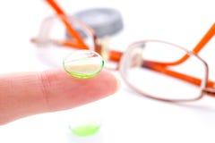 Contact lens on finger Stock Photos