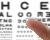 Contact lens on finger Stock Images