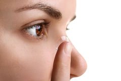 Contact lens. On your finger comes to the eye on a white isolated background Royalty Free Stock Images