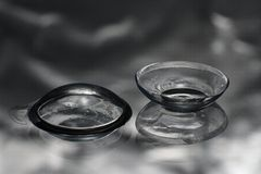 Contact lenses. Two contact lenses on reflective surface Royalty Free Stock Photos