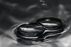 Contact lenses. Two contact lenses on reflective surface Stock Images