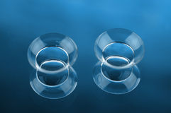 Contact lenses. Two contact lenses with reflections on blue surfaces Stock Photography