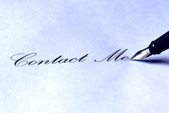 Contact Me!. The writing Contact Us! and a fountain pen - in blue color Stock Photography