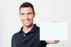 Contact me ! showing business card. Young man with white card, focus on card Royalty Free Stock Images