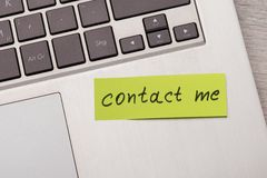 Contact me sticky note on laptop Stock Photo