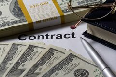 Contact money glasses close-up Royalty Free Stock Image