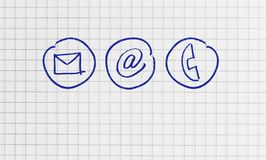 Contact options on checkered writing pad concept stock photos