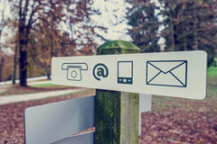 Contact signboard in an autumn park Stock Photography