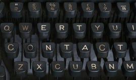 Contact - Typewriter. Close up of vintage typewriter keyboard showing CONTACT Royalty Free Stock Images