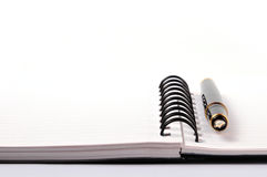 Contact us. Concept - pen and notebook on white Royalty Free Stock Image