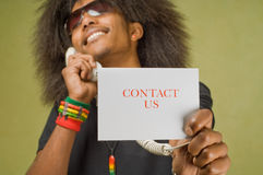 Contact Us. Young Trendy African American Male Holding Card with Phone, Contact Us Royalty Free Stock Photography