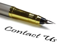 Contact us. Fountain pen and contact us text on white background Royalty Free Stock Image