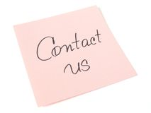 Contact us. Handwritten message on pink sticker Royalty Free Stock Image
