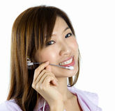 Contact Us!. Friendly Customer Representative with headset smiling during a telephone conversation Royalty Free Stock Images