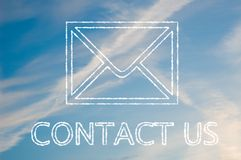 Contact us. The letters contact us written with cloud letters underneath a telephone symbol Royalty Free Stock Photos
