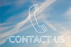 Contact us. The letters contact us written with cloud letters underneath a telephone symbol Stock Photography