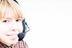 Contact us. Blond girl smiling with headphones, contact us idea Stock Photography