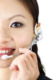 Contact Us. Friendly Customer Representative with headset smiling during a telephone conversation Stock Image