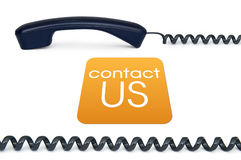 Contact us. Black handset isolated on a white background with the sign contact us Royalty Free Stock Photos