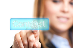 Contact us. Beautiful woman pressing an email button Stock Photography