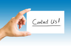 Contact Us. Hand Showing Notice Paper With Text Contact Us Royalty Free Stock Images