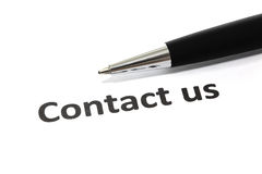 Contact us. With pen Royalty Free Stock Photography
