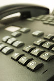 Contact us. Closeup of Black phone on white background Stock Photography