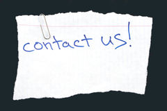 Contact Us. Message Isolated on Black stock photo
