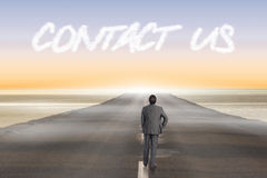 Contact us against road leading out to the horizon Stock Images