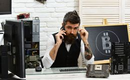 Contact us. Bitcoin miner man talk on phone in server room. Crypto currency mining hardware. Bearded man with computer. Circuits for bitcoin mining. Bearded stock image