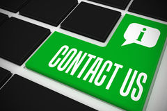 Contact us on black keyboard with green key Stock Image