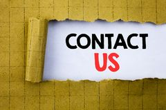Contact Us. Business concept for Customer Support written on white paper on the yellow folded paper. Contact Us. Business concept for Customer Support written stock photography