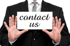 Contact Us. Businessman shows business card Stock Images