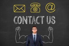 Free Contact Us Button On Blackboard Background Stock Photo - 183582120